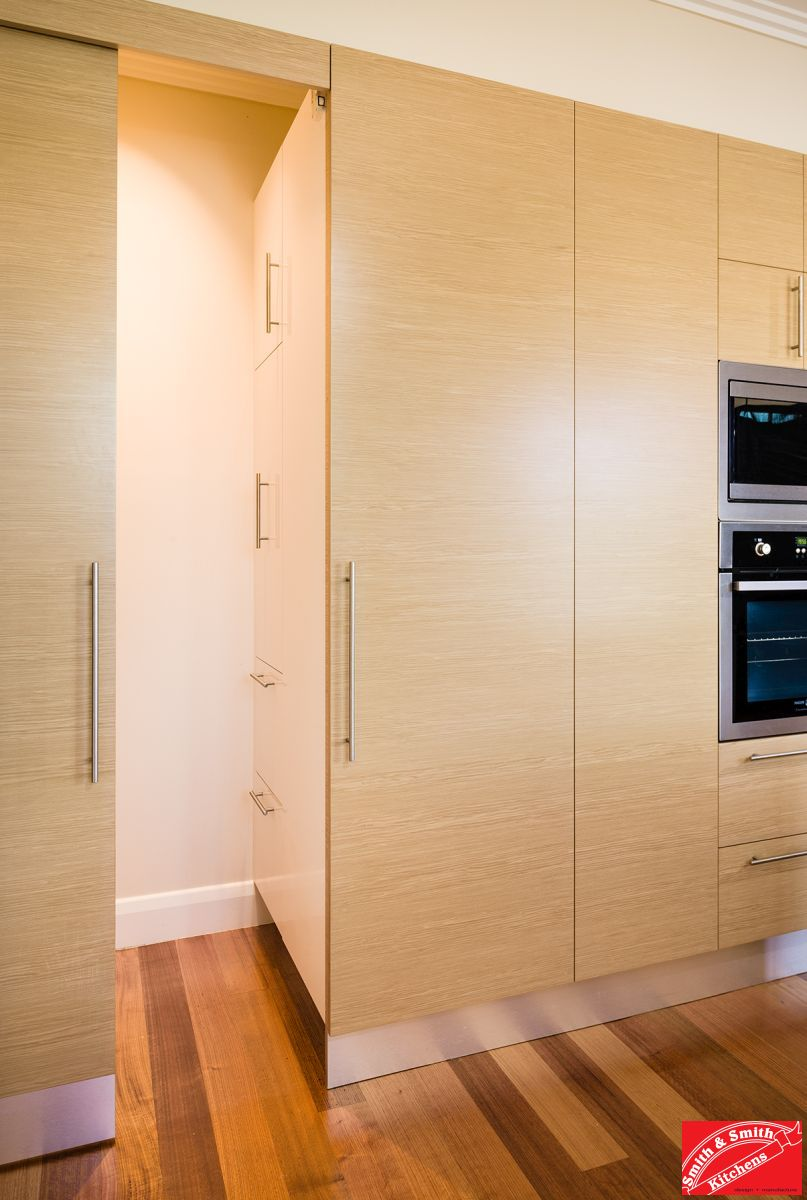 Medium kitchen, timber veneer, hidden storage.