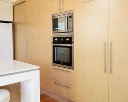 Medium kitchen, timber veneer, hidden storage