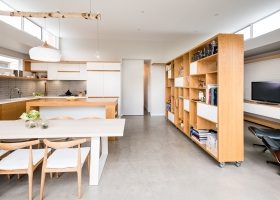 Relocatable shelving on wheels, floating desk