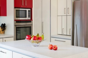 Mini bi-fold doors conceal an appliance cabinet.