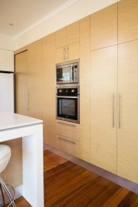 A sliding door in the same finish as the cabinetry.