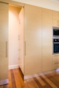 A cleverly hidden door reveals more storage.