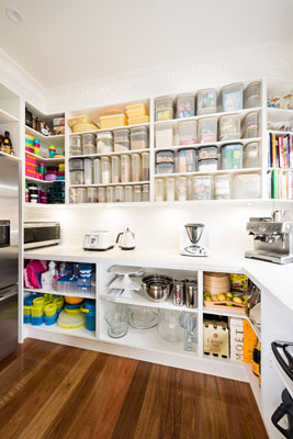 Masses of shelf and bench space in this butler's pantry.