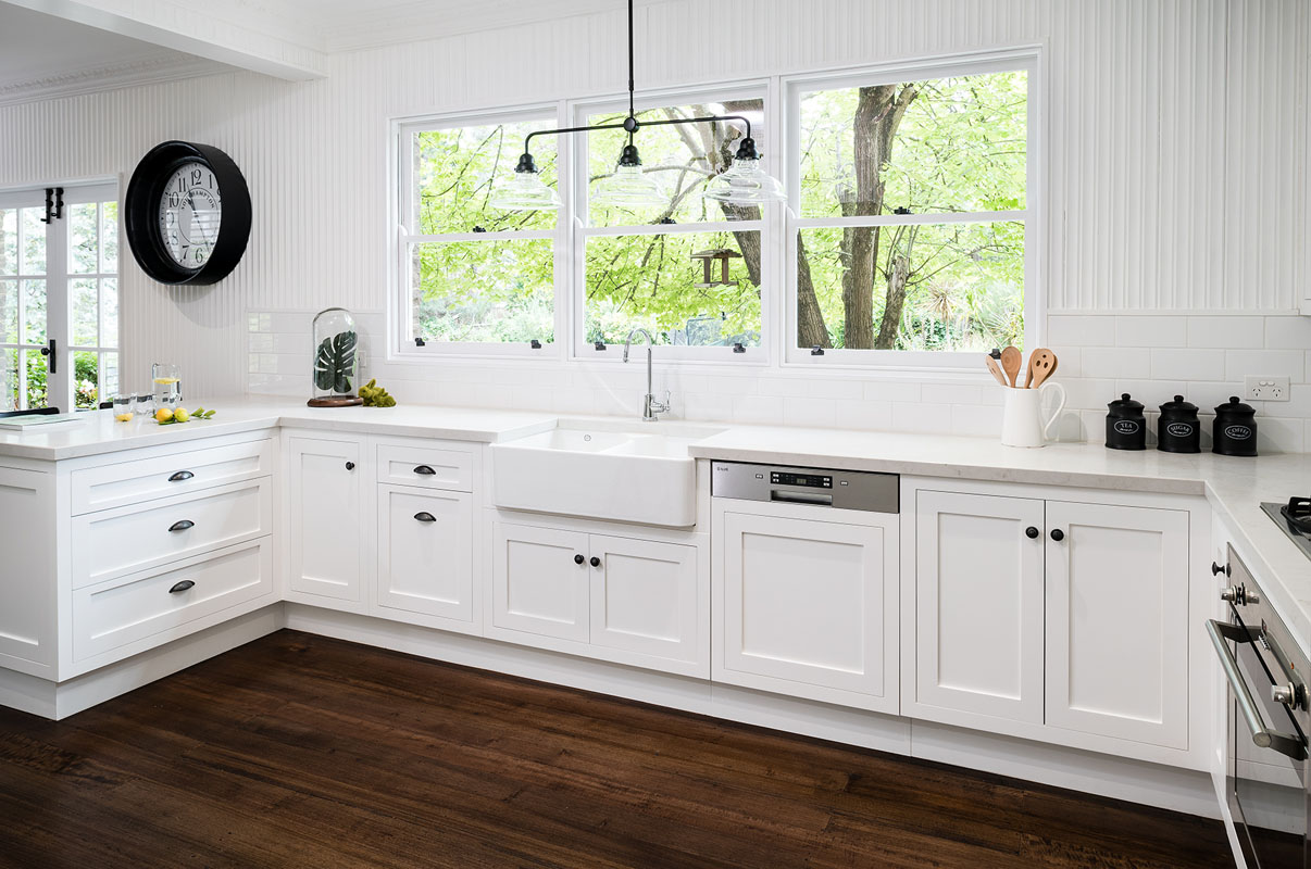 Hamptons style kitchen with shaker door profiles. Sink looks over the beautiful greenery in the garden.